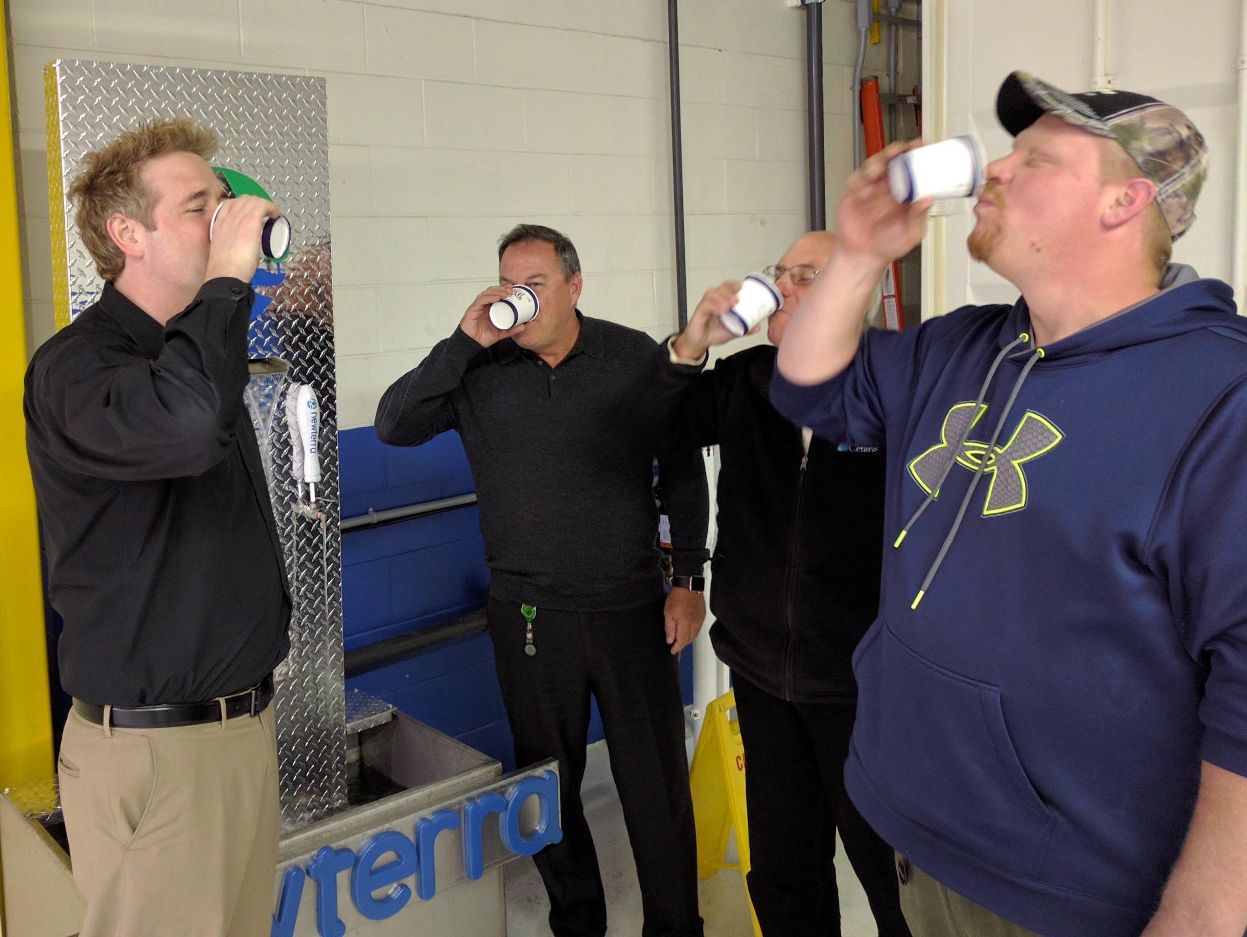 Management Team Drinking Potable Water from Toilet To Tap MBR system by Newterra
